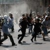 Greek lawmakers pass new austerity law despite violent protests