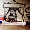 Street Artist Spray Paints Homes For Those Without To Highlight Poverty