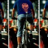 Bicycle-Mounted Device Projects Relevant Signals Onto Cyclists' Backs