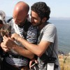 Is This The Face Of Terrorism? Syrian Refugee Cradles Kitten Stowaway On Successful Journey To Greece