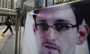 a-banner-supporting-edward-snowden-is-displayed-in-hong-kongs-business-district-june-20