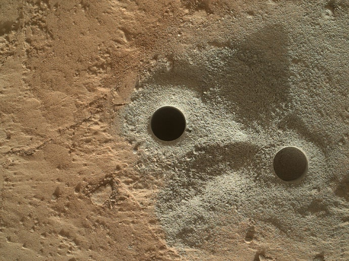 """This handout provided March 30, 2013 by NASA shows holes drilled into rock by NASA's Mars rover Curiosity in the """"Yellowknife Bay"""" area of Gale Crate (AFP Photo / NASA)"""