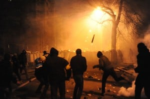 Image Credit: Wikipedia Protesters throwing pieces of paving during and metal tubes at riot police during clashes at Bankova str, Kiev, Ukraine.