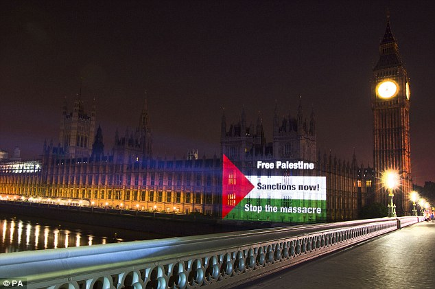 Stunt: A Palestinian flag calling for 'Sanctions now' was projected onto the Houses of Parliament.