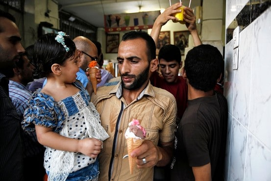 Palestinians crowd into an ice cream shop during the first day of a three day ceasefire in Gaza City on Tuesday. Finbarr O'Reilly/Reuters