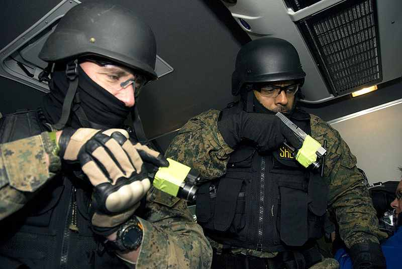 Marion County SWAT Team members check passengers on the bus. (Photo: Wikimedia Commons)