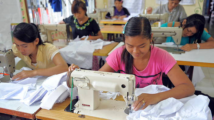 Cambodian female workers sew at a factory in Sihanouk province, some 230 kilometers southwest of Phnom Penh on September 9, 2009.   Credit: SBS.com