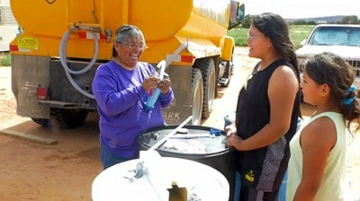"Navajo ""Water Lady"" Drives 75 Miles Each Day To Bring Water To Houses Without Plumbing"