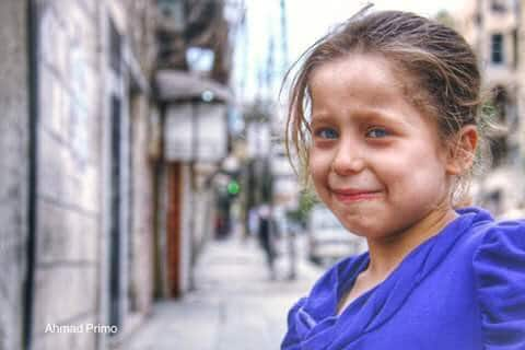 The terrified face of a Syrian child in Raqqah. Did SHE attack Paris?