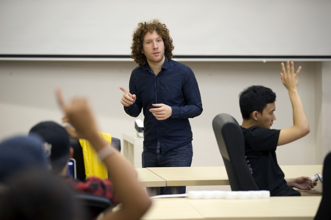 """Jeremy Rossmann, 24, co-founder of Make School, a new two-year """"college replacement"""" program for aspiring app developers and entrepreneurs, delivers a class lecture, Monday, Oct. 26, 2015, in San Francisco, Calif. Students pay nothing up front for their education, but agree to pay a percentage of their salary for the first two years after graduating. (D. Ross Cameron/Bay Area News Group)"""