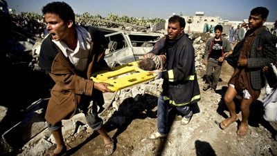 People carry the body of a child they uncovered from under the rubble of houses destroyed by Saudi airstrikes near Sanaa Airport, Yemen, Thursday, March 26, 2015. Saudi Arabia launched airstrikes Thursday targeting military installations in Yemen held by Shiite rebels who were taking over a key port city in the country's south and had driven the embattled president to flee by sea, security officials said. (AP Photo/Hani Mohammed)
