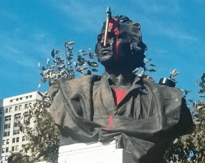 Someone Stuck An Ax Into This Statue Of Christopher Columbus