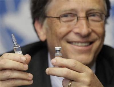 Bill Gates, co-chair of the Bill & Melinda Gates Foundation poses with vaccine against meningitis during a news conference after his address to the 64th World Health Assembly at the United Nations European headquarters in Geneva May 17, 2011. REUTERS/Denis Balibouse