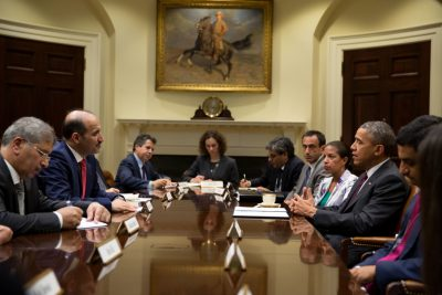 President Barack Obama drops by National Security Advisor Susan E. Rice's meeting with Syrian Opposition Coalition President Ahmad Jarba, second from left, in the Roosevelt Room of the White House, May 13, 2014. (Official White House Photo by Pete Souza)  This official White House photograph is being made available only for publication by news organizations and/or for personal use printing by the subject(s) of the photograph. The photograph may not be manipulated in any way and may not be used in commercial or political materials, advertisements, emails, products, promotions that in any way suggests approval or endorsement of the President, the First Family, or the White House.
