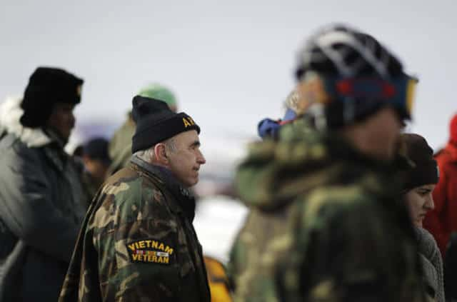 Vietnam Army veteran Dan Luker, of Boston, attends a briefing for fellow veterans at the Oceti Sakowin camp where people have gathered to protest the Dakota Access oil pipeline in Cannon Ball, N.D., Saturday, Dec. 3, 2016. (AP Photo/David Goldman)