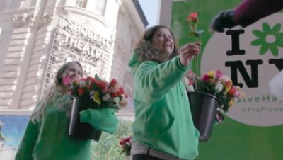 Activists Pass Out 10,000 Roses To New Yorkers On International Happiness Day