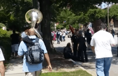 Sousaphone Player Heroically Trolls KKK By Playing Doofy Music [Watch]