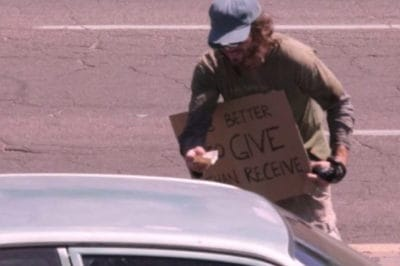 Man In Disheveled Clothes Surprises Strangers By Handing Them The One Thing They Don't Expect…