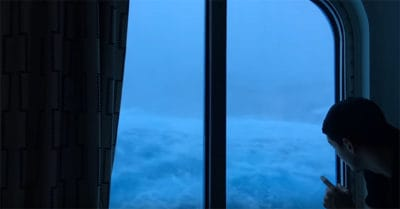 Insane Footage Shows Giant Waves Crashing Into A Cruise Ship While He Just Looks Out The Window