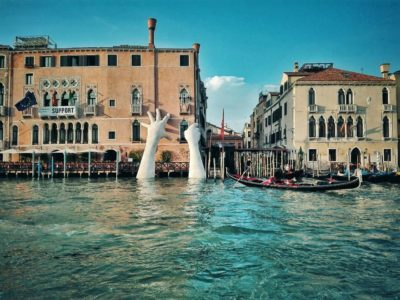 Giant Hands Rising From Venice Canals Send Important Message About Climate Change
